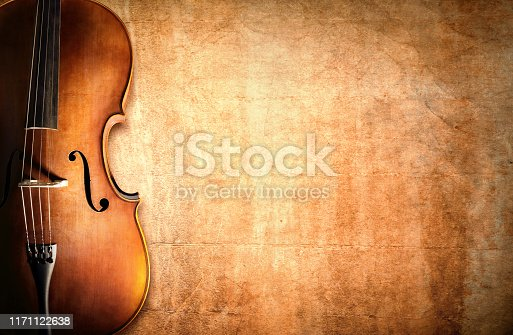 istock Cello and blank grunge background 1171122638