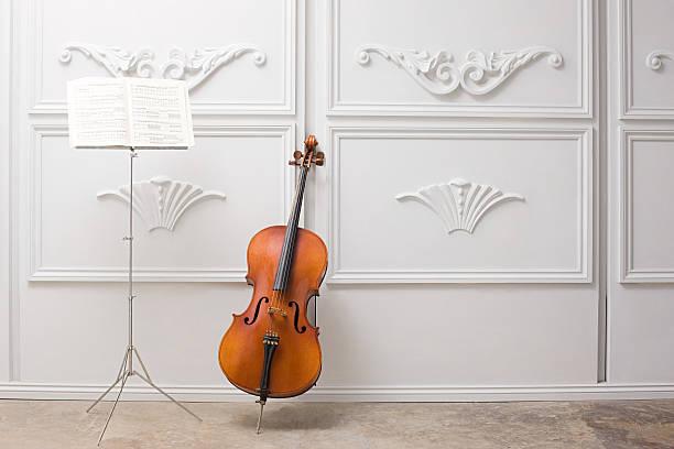 cello und notenständer - notenständer stock-fotos und bilder