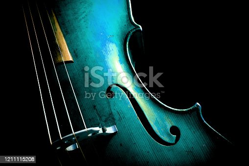 Cello in aqua menthe on dark background.