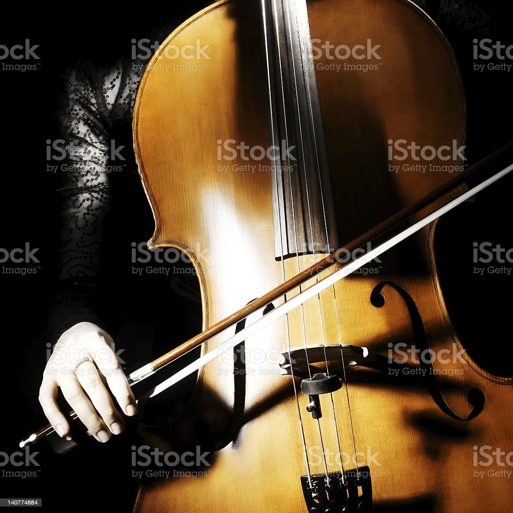 Cello musical instrument with cellist hand royalty-free stock photo