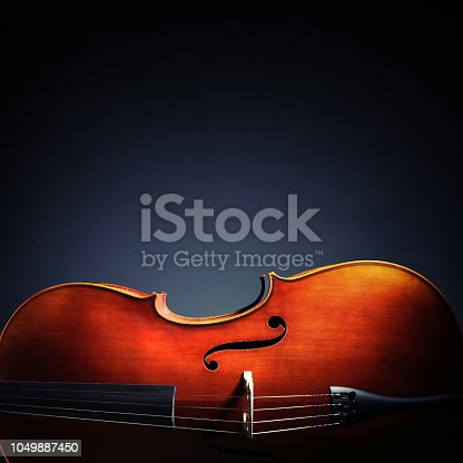 istock Cello on black background with copy space for music album or cd cover 1049887450
