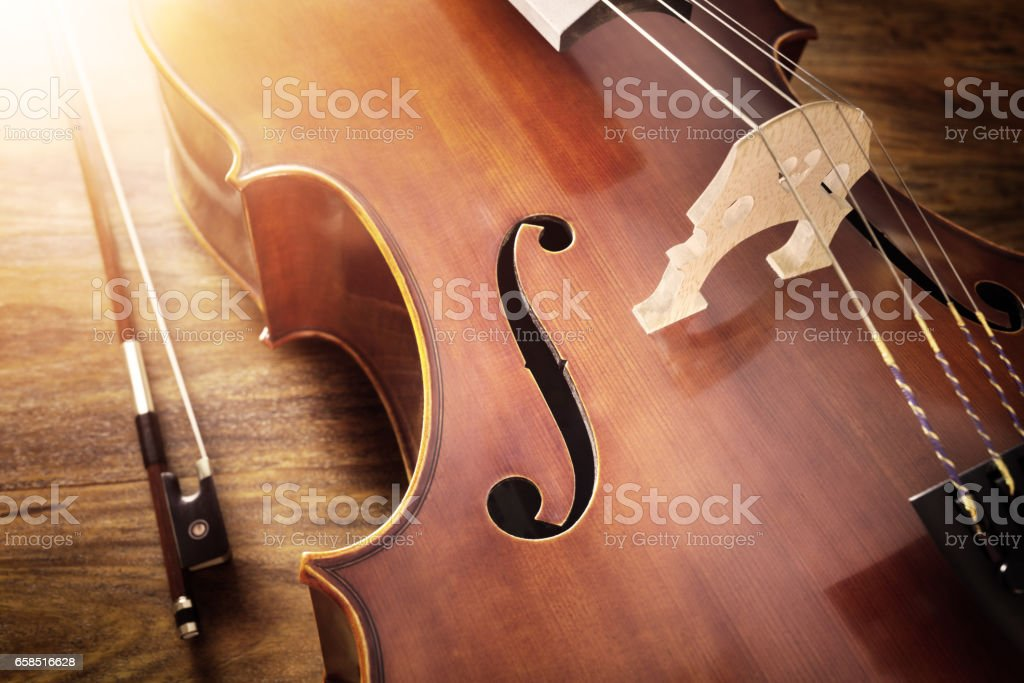 Cello on wood background stock photo