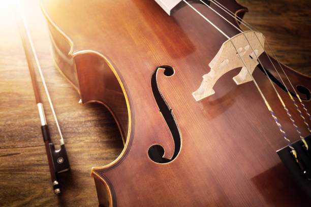 Cello on wood background Cello on wood background with copy space for music concept string instrument stock pictures, royalty-free photos & images
