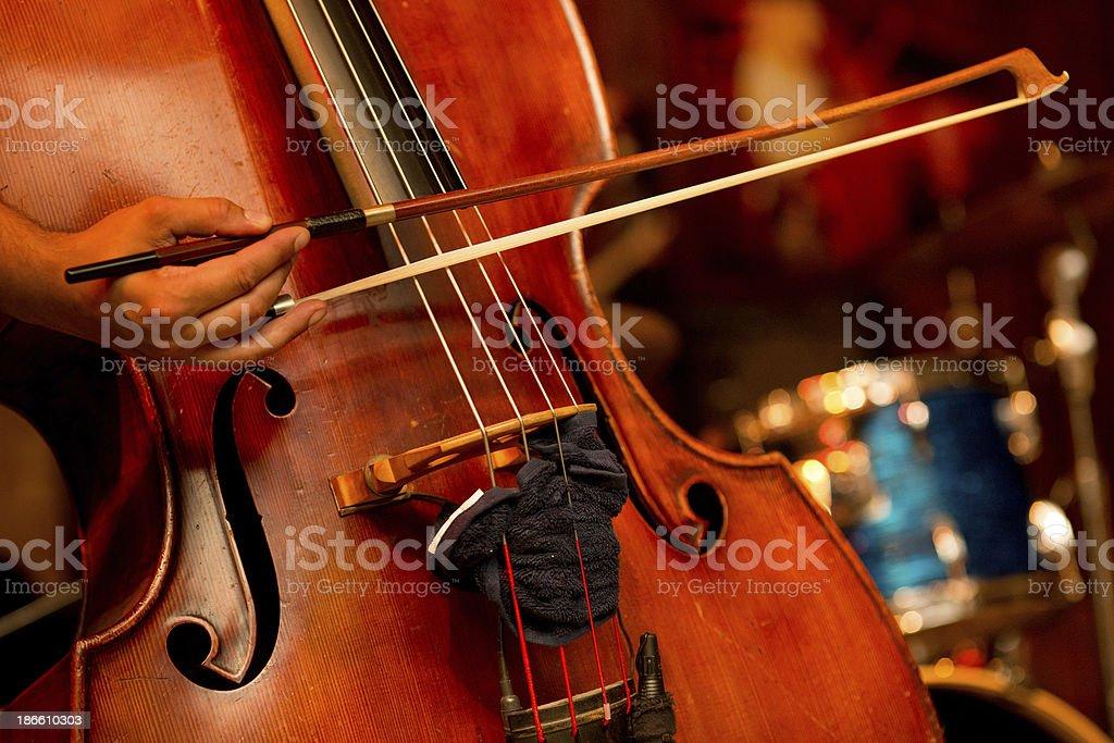 Cello player on stage stock photo
