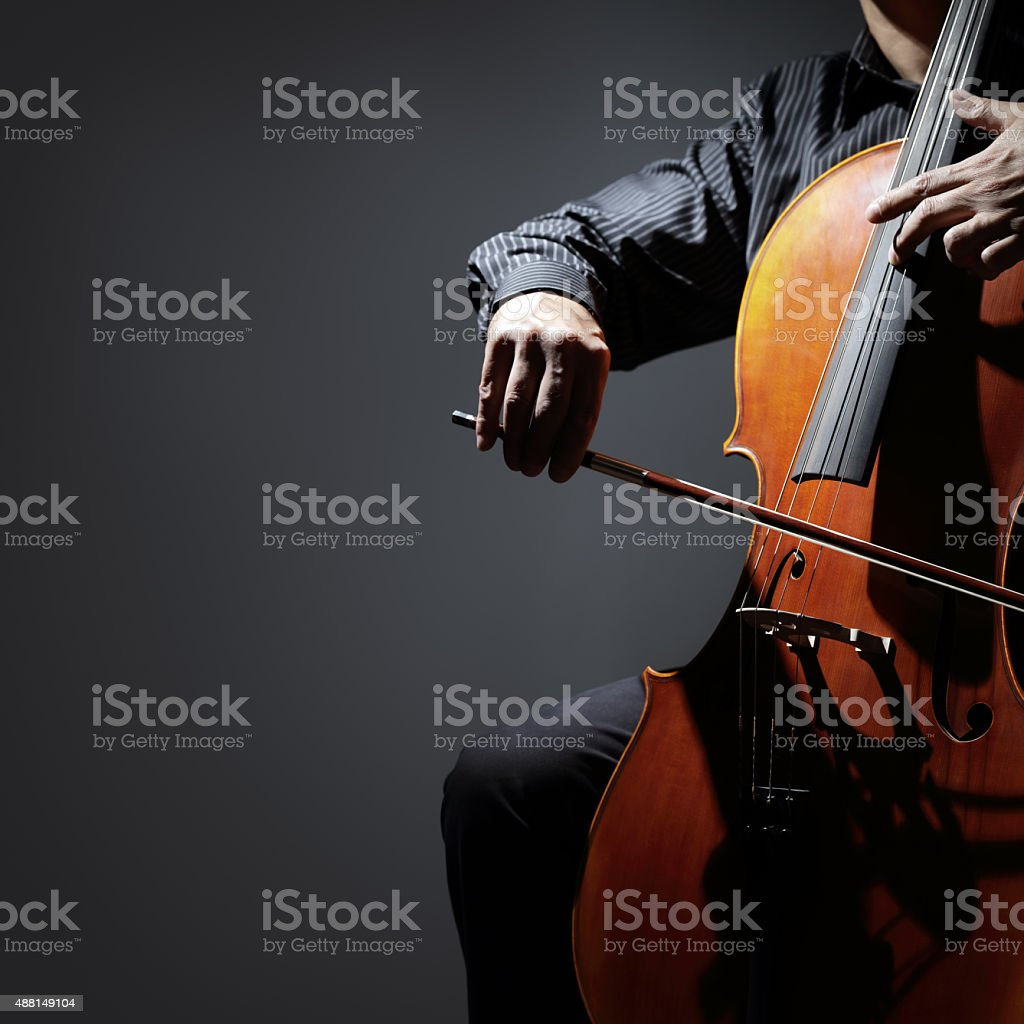 Cello player or cellist performing stock photo