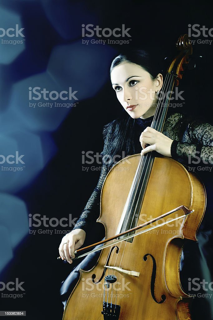 Cello playing cellist musician royalty-free stock photo