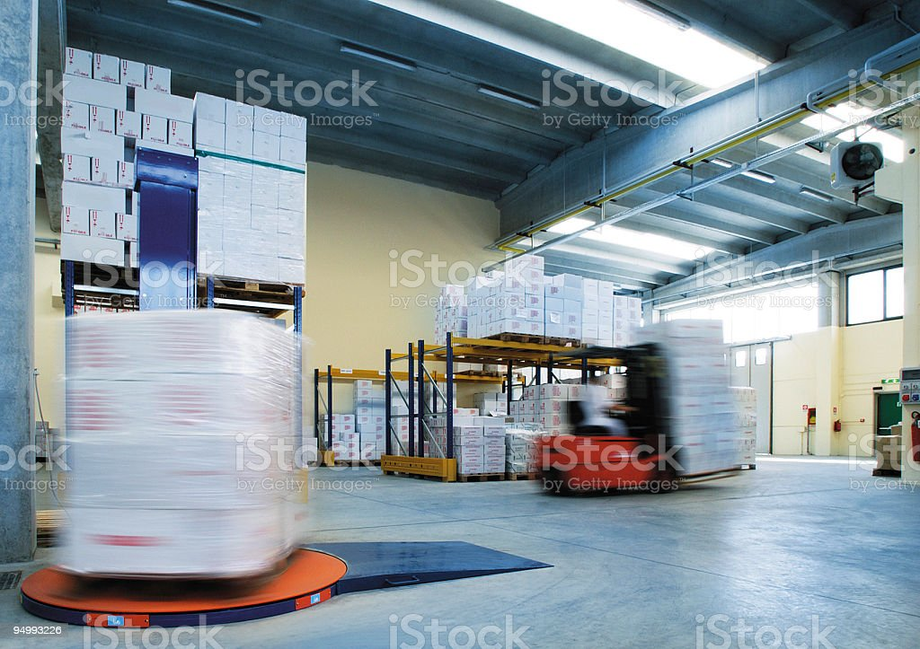 Cellophane packing of boxes before shipping, industrial warehouse stock photo