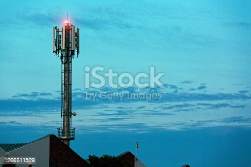Mobile phone tower against a lovely twilight sky.