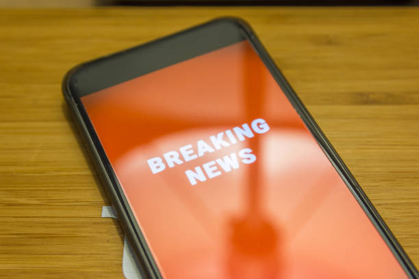 Cellphone Breaking News Alert stock photo