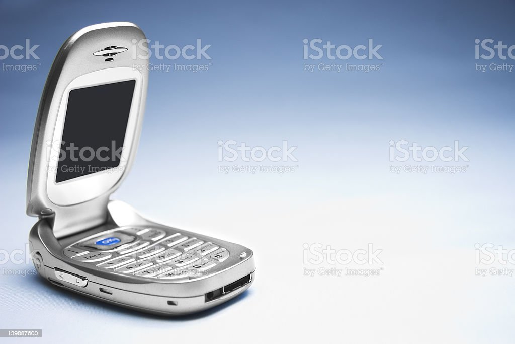 Cellphone on Blue Background stock photo