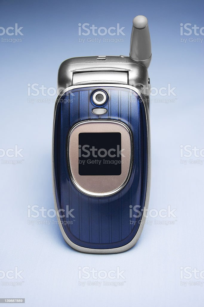 Cellphone on Blue Background royalty-free stock photo
