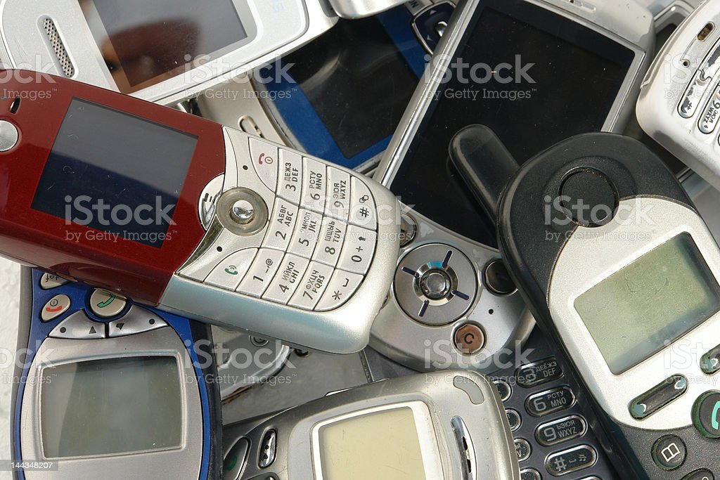 cellphones used old GSM Cell phones. Heap Stock Photo
