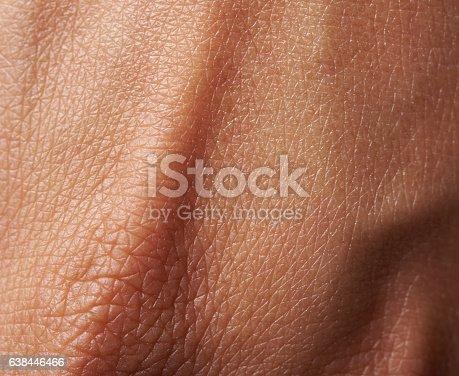 Cells on woman dark skin close up. Macro of human skin texture