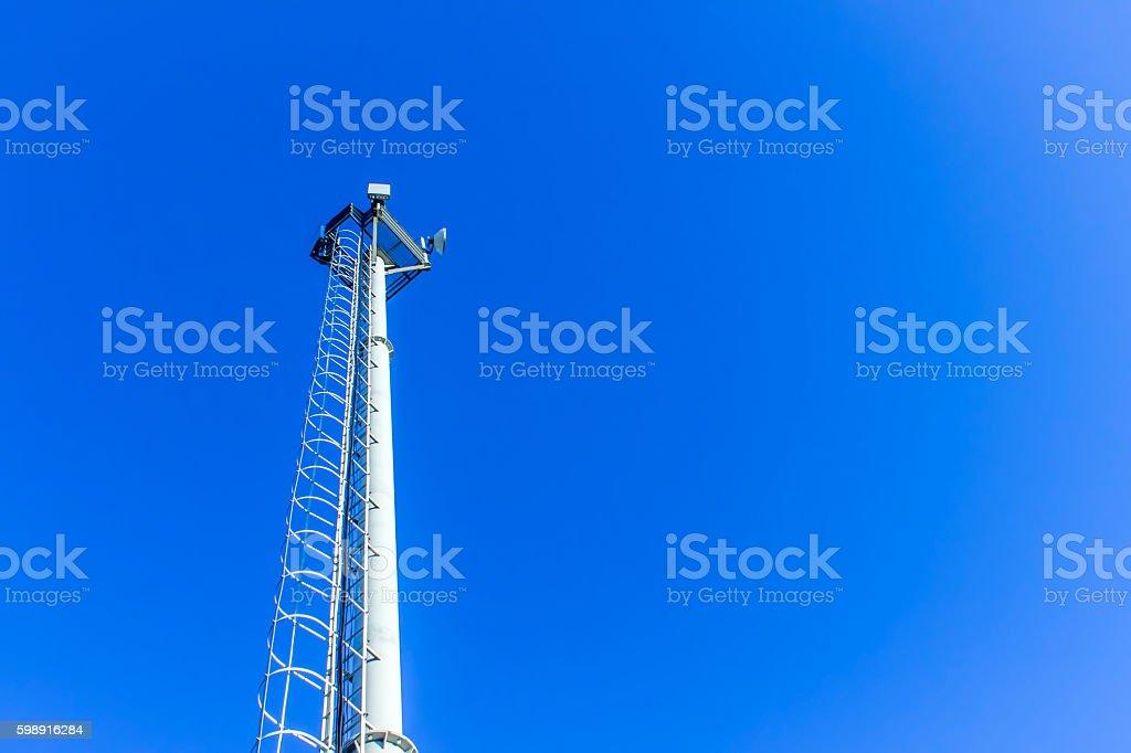 Cellular antenna against blue sky stock photo