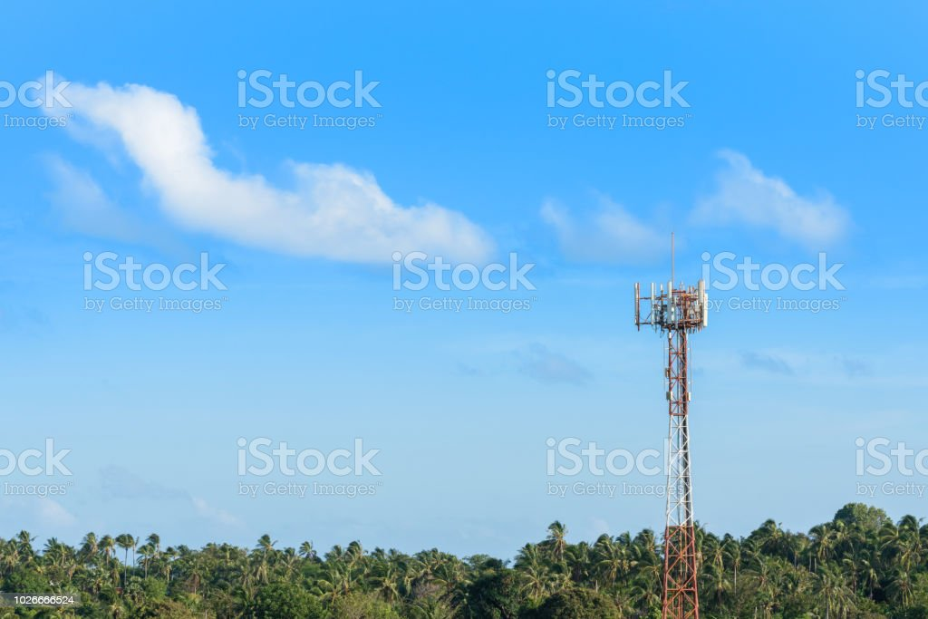 Cellular mobile antenna on telecommunication tower in tropic climate atmosphere, copy space on blue sky background. Mobile network communication or internet technology concept. stock photo