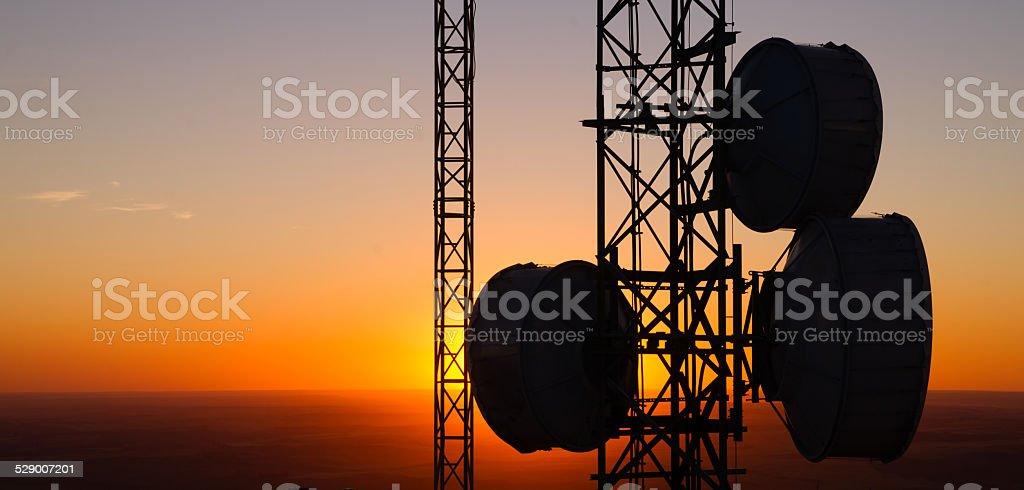 Cellular Radio Wave Communication Towers Evening Sunset Horizon stock photo