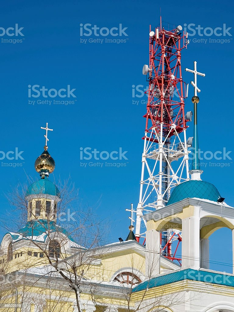 cellular tower and church blue sky communications cross royalty-free stock photo