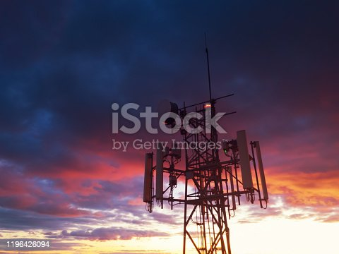 Aerial drone view of a cellular tower in evening light.