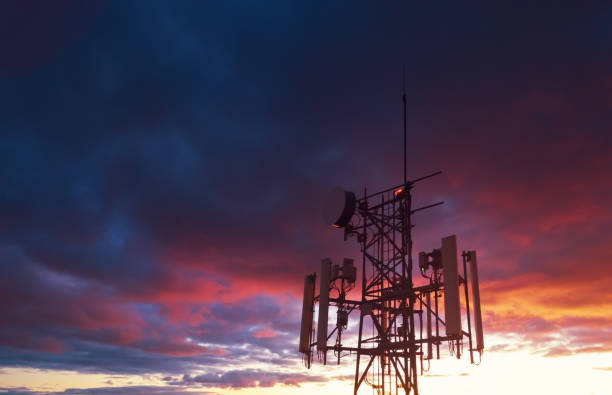 Cellular Tower Aerial drone view of a cellular tower in evening light. telecommunications equipment stock pictures, royalty-free photos & images