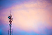 Cellular tower at sunset. Copy space.