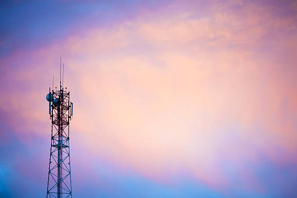 Cellular tower Cellular tower at sunset. Copy space. antenna aerial stock pictures, royalty-free photos & images