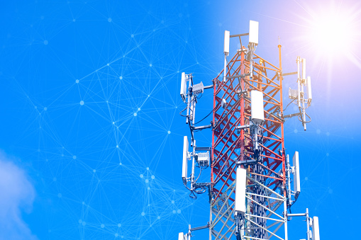 istock Cellular tower station for wireless telecommunication technology and blending with particles, glittering particles. Connection and mesh dots 1151155257