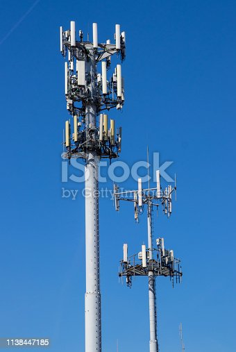 Cellular phone towers on a blue sky