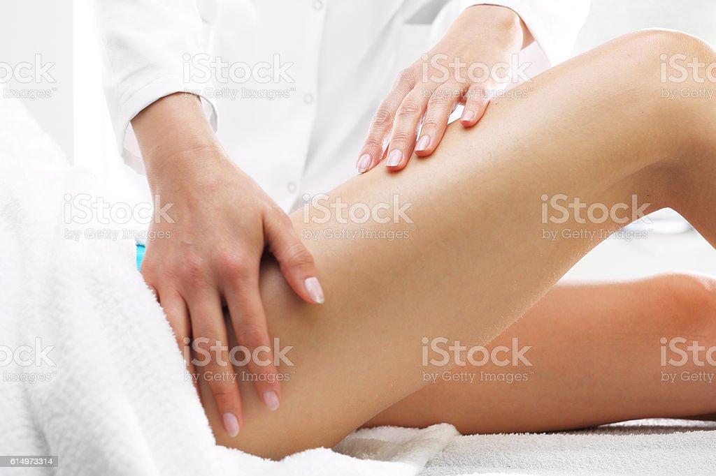 Cellulite, massage thigh. stock photo
