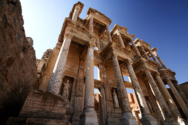 Celsius library seen from below on blue sky background View of Celsus Library at Ephesus ephesus stock pictures, royalty-free photos & images