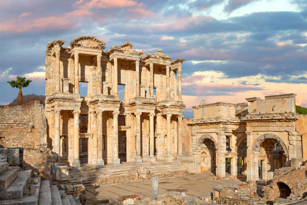Celsus library in the Roman ruins of Ephesus in Turkey, at the sunrise. stock photo