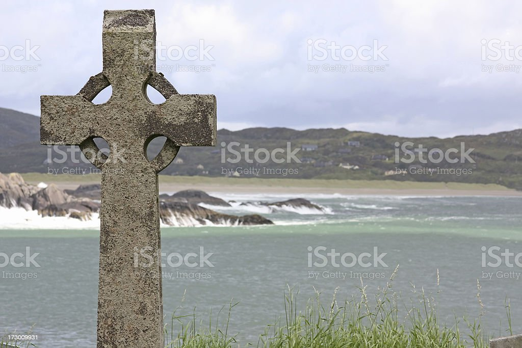 Celtic Cross in Ireland, ocean in the background stock photo
