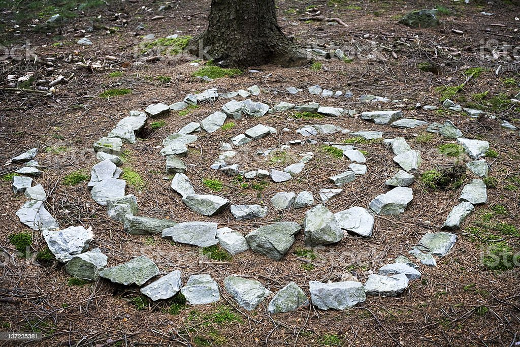 Celtic rune made out of stones in the forest stock photo