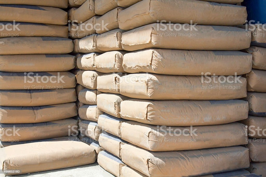 cement bags stacked in warehouse stock photo