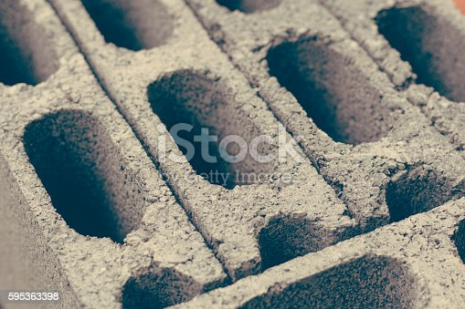 istock Cement brick background close up 595363398