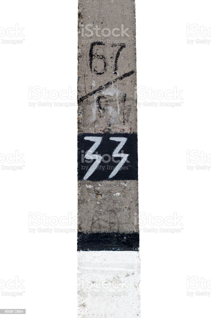 Cement column with the inscription white paint thirty three. stock photo