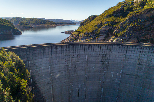 Cement dam wall creating hydro electricity aerial view in Tasmania