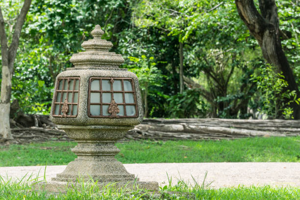 Cement Decoration pole light footpath in the garden stock photo