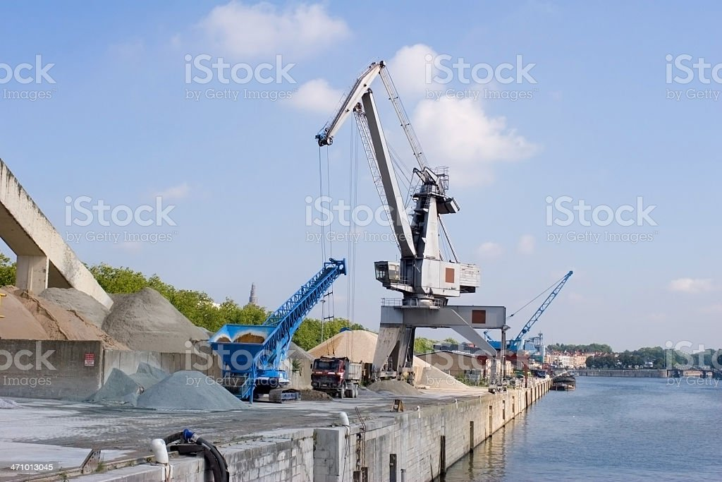 Cement factory at the harbor with crane royalty-free stock photo