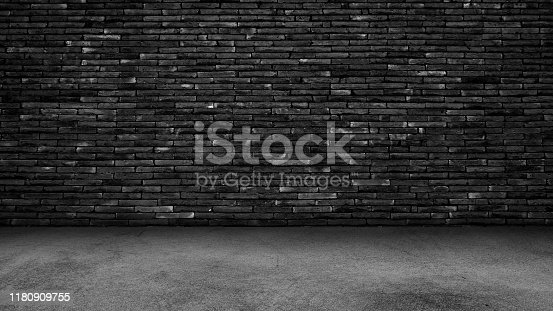 istock Cement floor background on studio room and spot light.Between darkness 1180909755