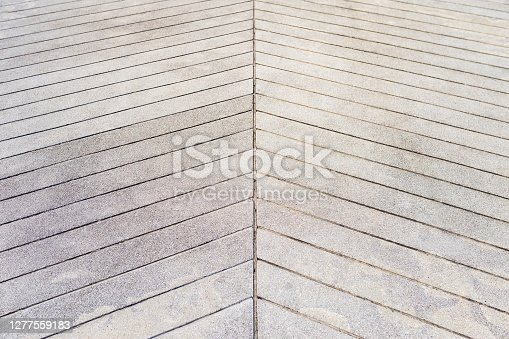 Cement floor with sloped surface pattern, floor design, construction concept background