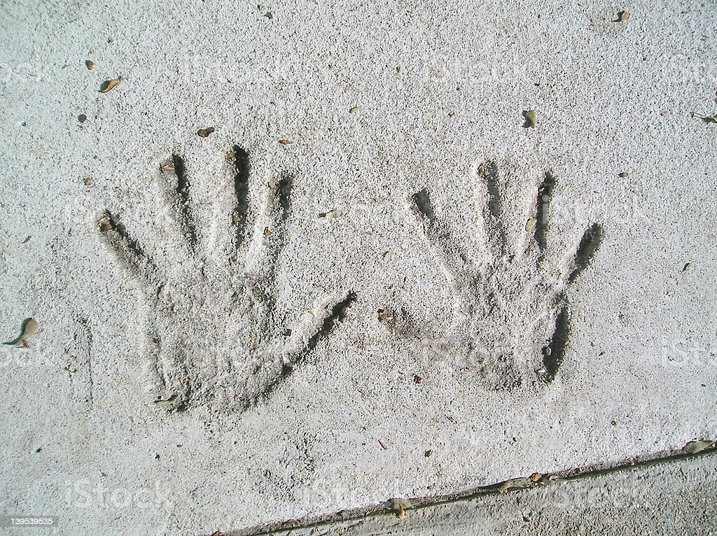 Child\'s pair of handprints in a sidewalk on Beacon St. in Boston