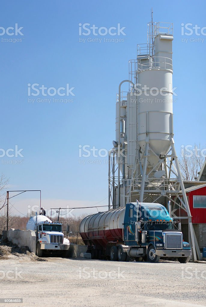 Cement Industrial Building and Trucks royalty-free stock photo