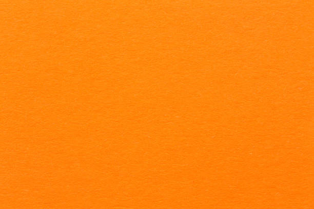 cement light orange background - orange color stock pictures, royalty-free photos & images