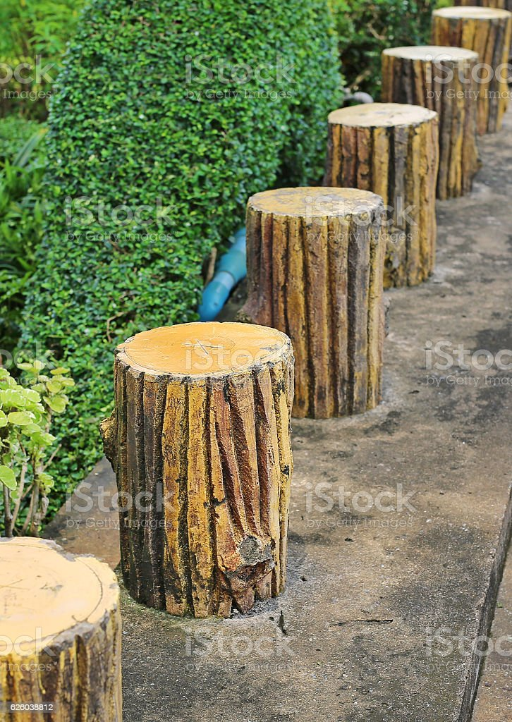 Cement log bench style in the garden. stock photo