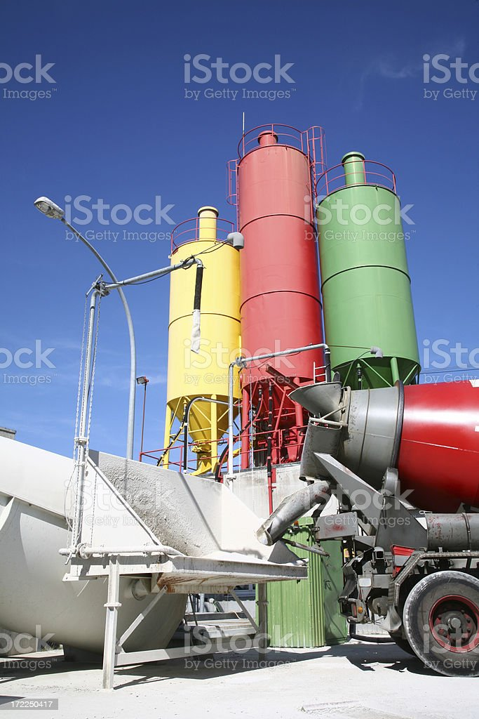 Cement mixer in front of three tanks royalty-free stock photo