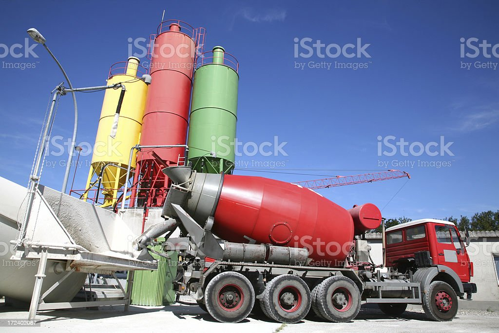 Cement mixer near three colorful tanks royalty-free stock photo