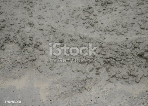 1138442636istockphoto Cement mortar on the surface 1179283095