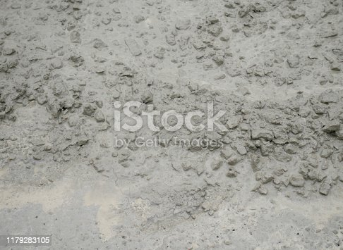 1138442636istockphoto Cement mortar on the surface 1179283105