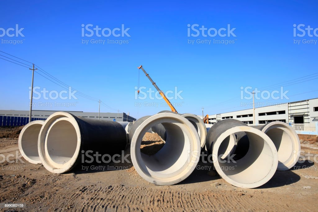 Cement pipe in the construction site stock photo