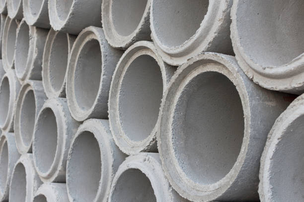 cement pipes for construction water system. - construction material stock photos and pictures